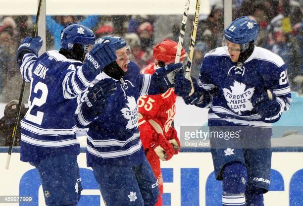 Tyler Bozak Phil Kessel and James van Riemsdyk of the Toronto Maple Leafs celebrate van Riemsdyk's goal against the Detroit Red Wings during the 2014...