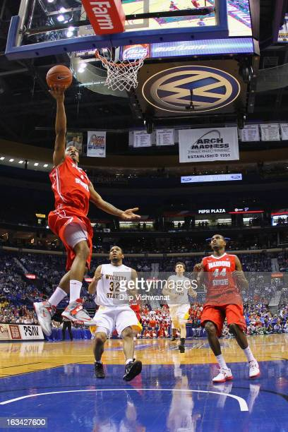 Tyler Brown of the Illinois State Redbirds goes for a layup against Tekele Cotton of the Wichita State Shockers during the semifinals of the Missouri...
