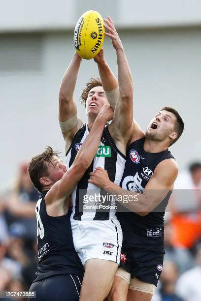 Tyler Brown of the Magpies flies for an attempted mark during the AFL Practice Match between the Carlton Blues and the Collingwood Magpies at Ikon...