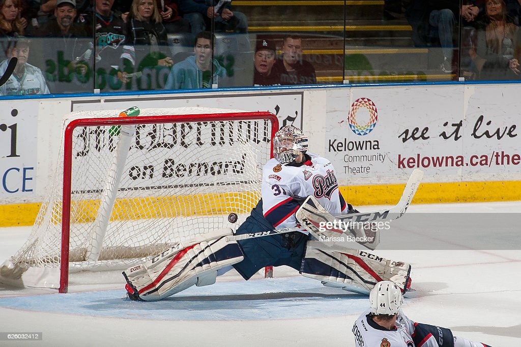 Tyler Brown #31 of the Regina Pats misses a save during overtime against the Kelowna Rockets on November 26, 2016 at Prospera Place in Kelowna, British Columbia, Canada.