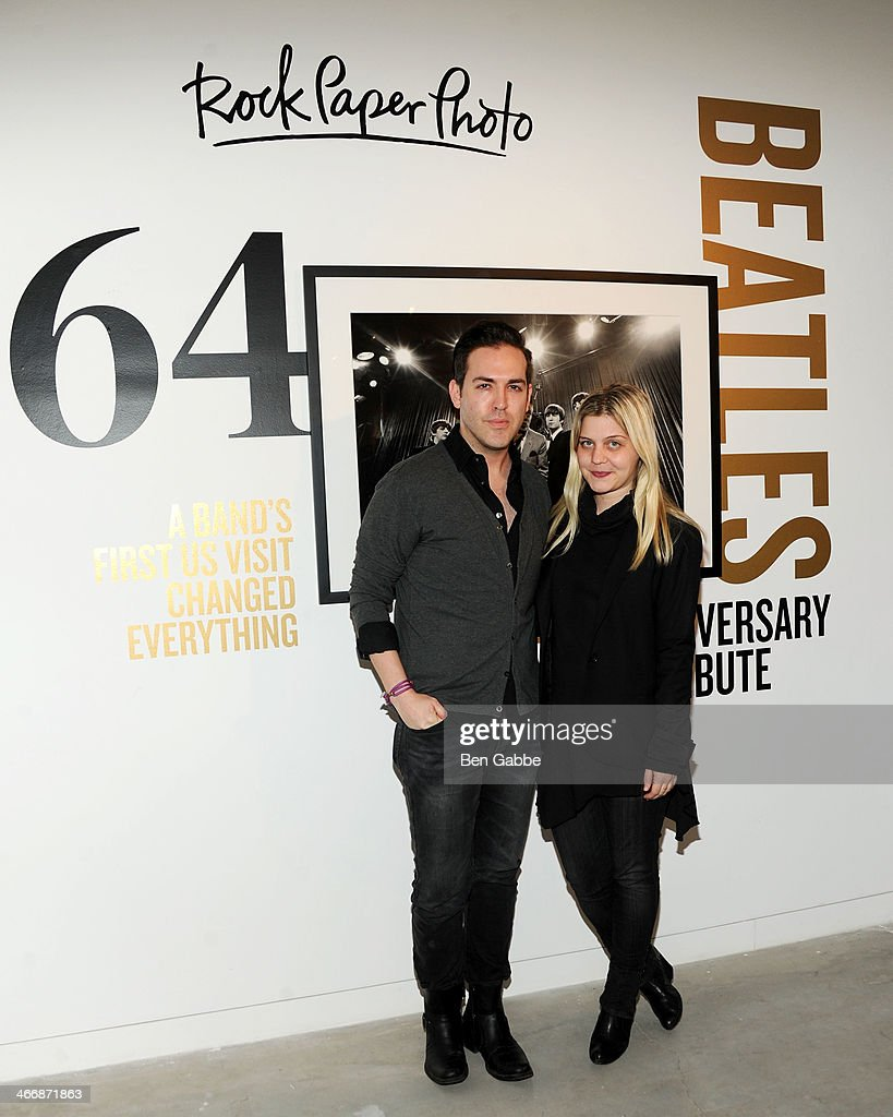 Tyler Burrow (L) and Stefanie Skinner attend The Beatles 50 Year Commemorative Anniversary photo exhibit at Rock Paper Photo NYC Pop Up Gallery on February 4, 2014 in New York City.