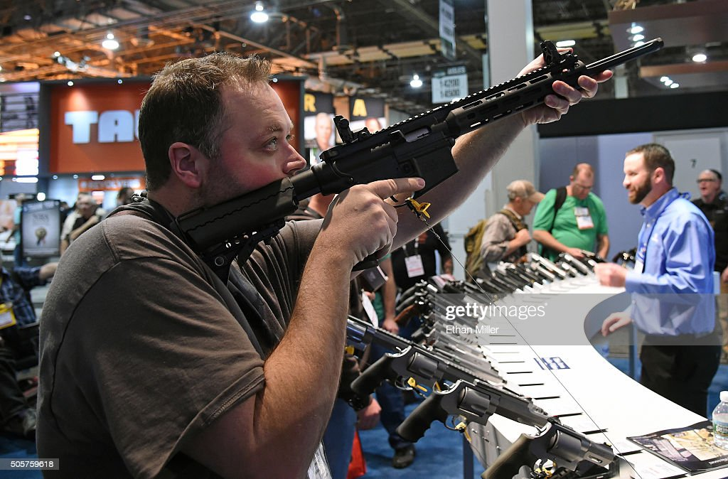 Tyler Burton tries out an M&P 15-22 Sport rifle at the Smith & Wesson booth at the 2016 National Shooting Sports Foundation's Shooting, Hunting, Outdoor Trade (SHOT) Show at the Sands Expo and Convention Center on January 19, 2016 in Las Vegas, Nevada. The SHOT Show, the world's largest annual trade show for shooting, hunting and law enforcement professionals, runs through January 23 and is expected to feature 1,600 exhibitors showing off their latest products and services to more than 62,000 attendees.