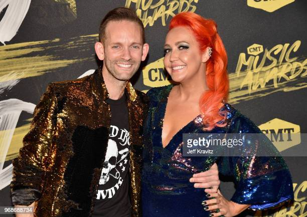 Tyler Cain and Meghan Linsey attend the 2018 CMT Music Awards at Nashville Municipal Auditorium on June 6 2018 in Nashville Tennessee
