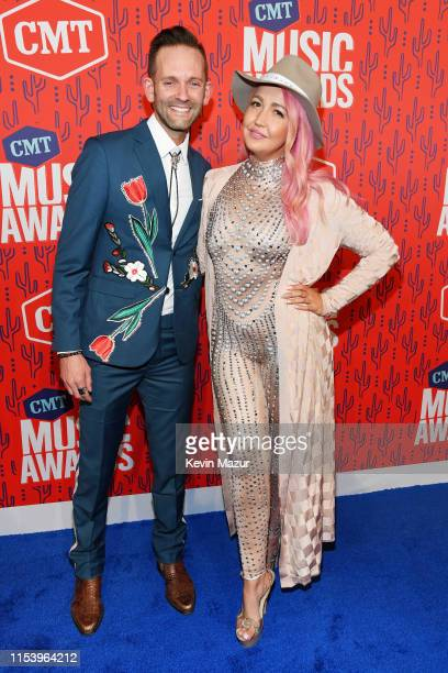 Tyler Cain and Meghan Linsey attend the 2019 CMT Music Award at Bridgestone Arena on June 05 2019 in Nashville Tennessee