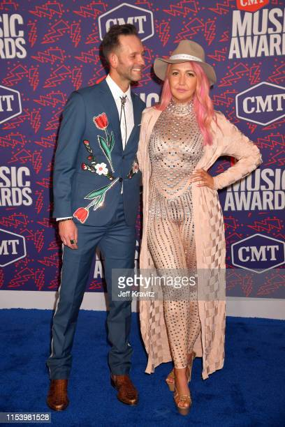 Tyler Cain and Meghan Linsey attend the 2019 CMT Music Awards at Bridgestone Arena on June 05 2019 in Nashville Tennessee