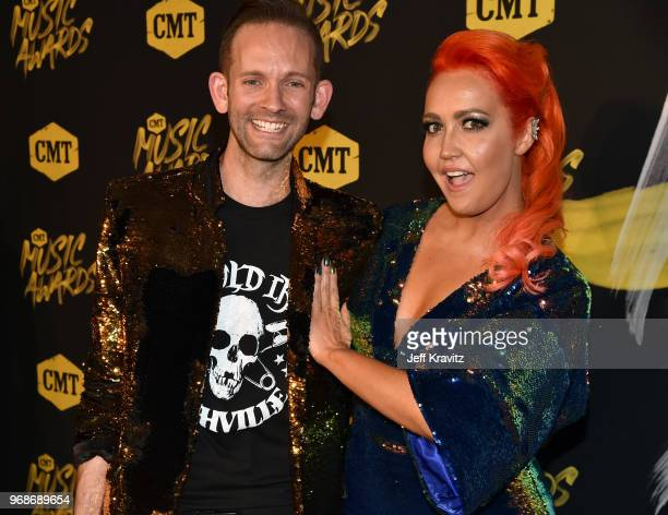 Tyler Cain and Meghan Linsey attends the 2018 CMT Music Awards at Nashville Municipal Auditorium on June 6 2018 in Nashville Tennessee