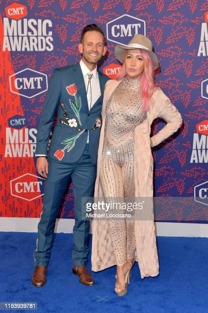 Tyler Cain and Meghan Linsey attends the 2019 CMT Music Awards at Bridgestone Arena on June 05 2019 in Nashville Tennessee