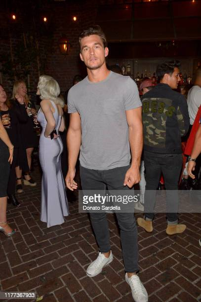 Tyler Cameron attends GUESS Celebrates Launch Of New Fragrance Seductive Noir For Men Women at No Vacancy on September 26 2019 in Los Angeles...