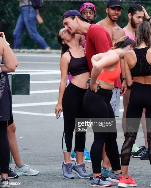 Tyler Cameron gets a kiss on the cheek from a fan in Central Park on August 14 2019 in New York City