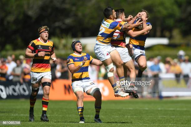 Tyler Campbell of Waikato competes with Terrence Hepetema and Richard Judd of Bay of Plenty for a high ball during the round nine Mitre 10 Cup match...