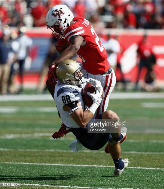Tyler Carmona of the Navy Midshipmen catches a pass as Terrell Williams of the Houston Cougars defends on November 24 2017 in Houston Texas