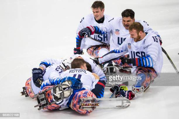 Tyler CARRON Josh PAULS Declan FARMER Ralph DEQUEBEC and JR_Billy HANNING celebrate winning the gold medal over Canada in the Ice Hockey gold medal...