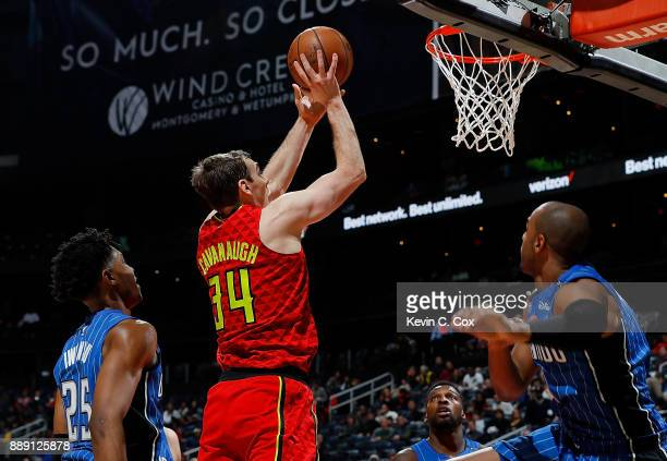 Tyler Cavanaugh of the Atlanta Hawks attempts a shot against Wesley Iwundu Shelvin Mack and Arron Afflalo of the Orlando Magic at Philips Arena on...