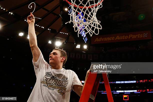 Tyler Cavanaugh of the George Washington Colonials cuts down the net after winning Most Outstanding Player during win over Valparaiso Crusaders...