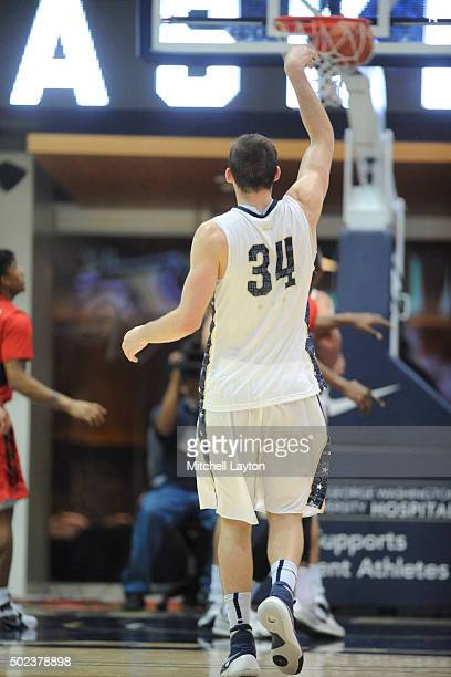 Tyler Cavanaugh of the George Washington Colonials hits a three point shot during a college basketball game against the Rutgers Scarlet Knights at...