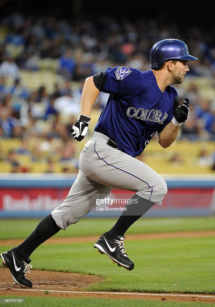 Tyler Chatwood #32 of the Colorado Rockies runs to first base after hitting single in the second inning against the Los Angeles Dodgers at Dodger Stadium on April 29, 2013 in Los Angeles, California.