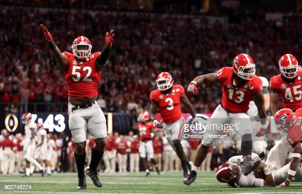 Tyler Clark and Roquan Smith of the Georgia Bulldogs celebrate a stop against the Alabama Crimson Tide during the first quarter in the CFP National...