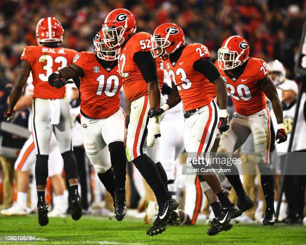 Tyler Clark Mark Webb and J R Reid of the Georgia Bulldogs celebrate after a key third down stop against the Auburn Tigers on November 10 2018 at...
