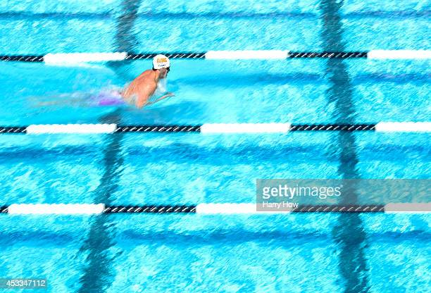Tyler Clary swims in the Men's 400 Meter IM Prelims during the 2014 Phillips 66 National Championships at the Woollett Aquatic Center on August 8...