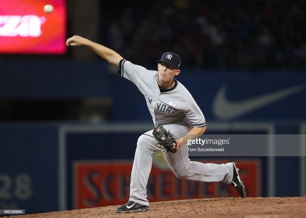 Tyler Clippard #29 of the New York Yankees delivers a pitch in the eighth inning during MLB game action against the Toronto Blue Jays at Rogers Centre on June 4, 2017 in Toronto, Canada.