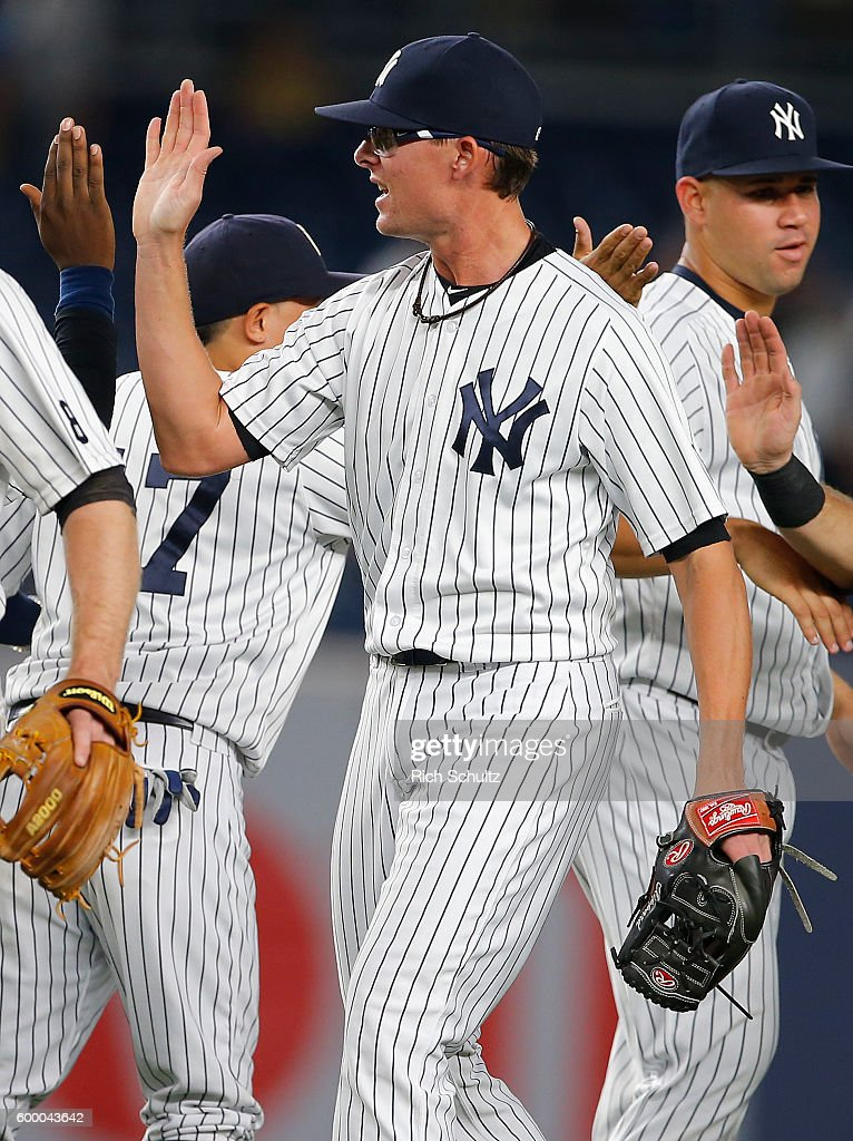 Tyler Clippard #29 of the New York Yankees is congratulated after earning his first save as a Yankee after defeating the Toronto Blue Jays 2-0 in a game at Yankee Stadium on September 7, 2016 in the Bronx borough of New York City.