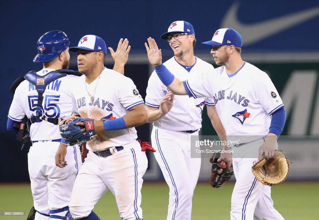 Tyler Clippard #36 of the Toronto Blue Jays celebrates their victory with Justin Smoak #14 and Yangervis Solarte #26 and Russell Martin #55 during MLB game action against the New York Yankees at Rogers Centre on July 6, 2018 in Toronto, Canada.