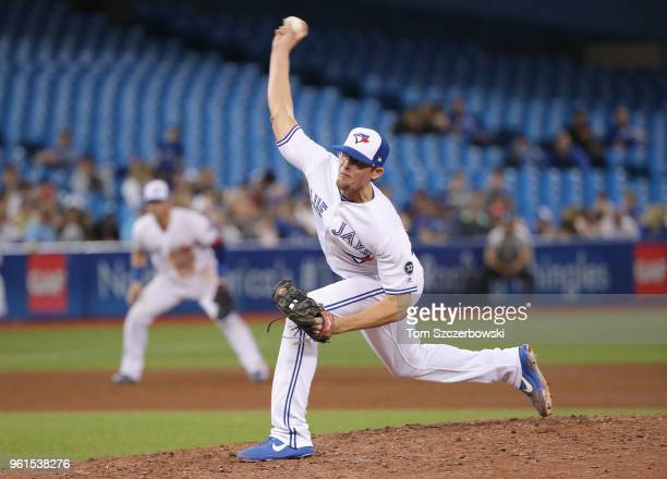 Tyler Clippard of the Toronto Blue Jays delivers a pitch in the ninth inning during MLB game action against the Los Angeles Angels of Anaheim at...