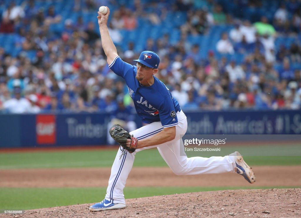 Tyler Clippard #36 of the Toronto Blue Jays delivers a pitch in the ninth inning during MLB game action against the Washington Nationals at Rogers Centre on June 16, 2018 in Toronto, Canada.