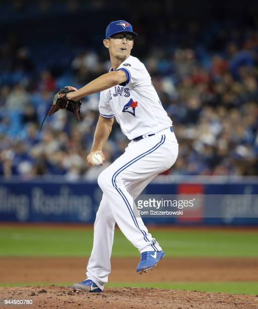 Tyler Clippard of the Toronto Blue Jays delivers a pitch in the eighth inning during MLB game action against the New York Yankees at Rogers Centre on...