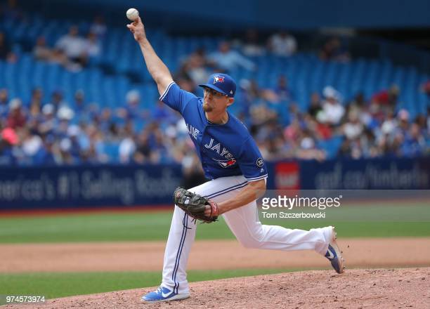Tyler Clippard of the Toronto Blue Jays delivers a pitch in the eighth inning during MLB game action against the Baltimore Orioles at Rogers Centre...