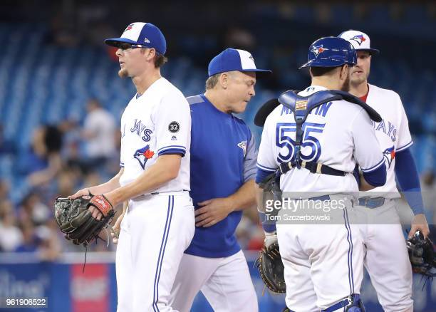 Tyler Clippard of the Toronto Blue Jays exits the game as he is relieved by manager John Gibbons in the ninth inning against the Los Angeles Angels...