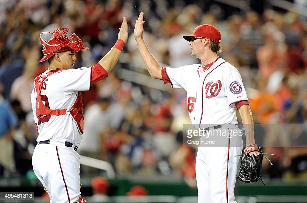 Tyler Clippard of the Washington Nationals celebrates with Wilson Ramos after a 70 victory against the Philadelphia Phillies at Nationals Park on...