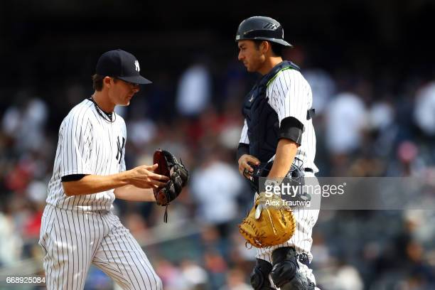 Tyler Clippard speaks with Kyle Higashioka of the New York Yankees during the game between the St Louis Cardinals and the New York Yankees at Yankee...