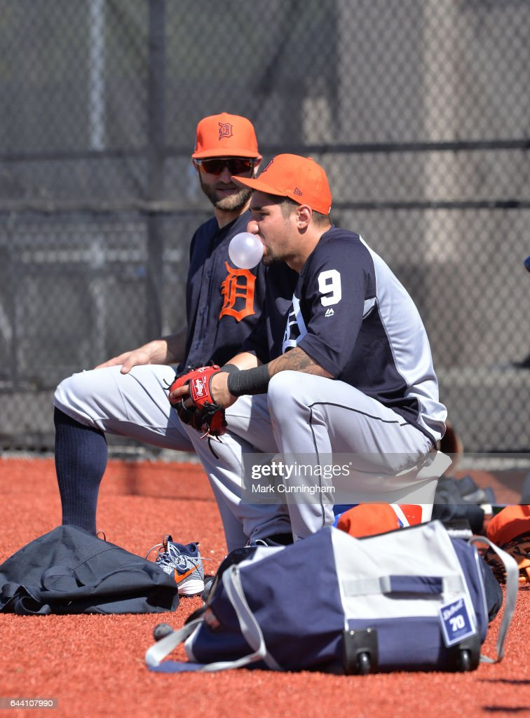 Tyler Collins #18 (L) and Nick Castellanos #9 of the Detroit Tigers sit together on the field during Spring Training workouts at the TigerTown facility on February 20, 2017 in Lakeland, Florida.