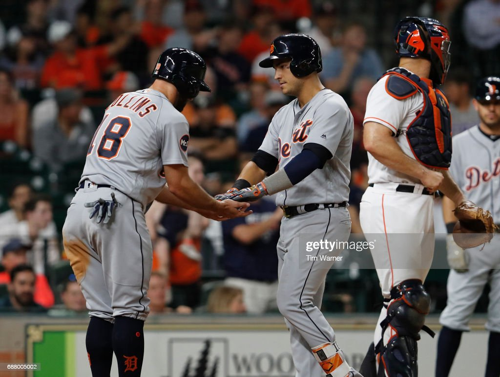 Tyler Collins #18 of the Detroit Tigers congratulates Jose Iglesias #1 after a ninth-inning home run against the Houston Astros at Minute Maid Park on May 24, 2017 in Houston, Texas.