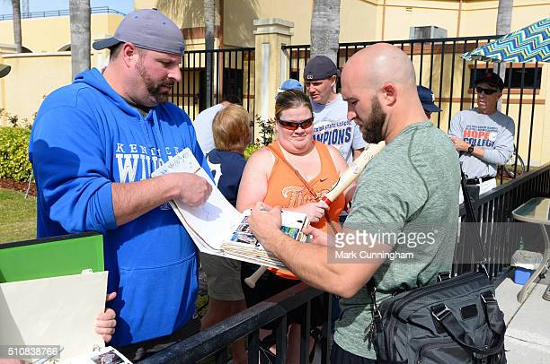 Tyler Collins of the Detroit Tigers signs autographs for fans outside of Joker Marchant Stadium after a Spring Training workout day on February 17...