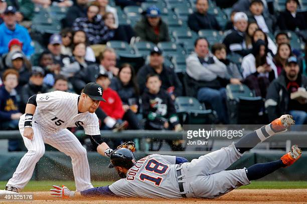 Tyler Collins of the Detroit Tigers slides safely into third base on a three run RBI triple as Gordon Beckham of the Chicago White Sox applies the...