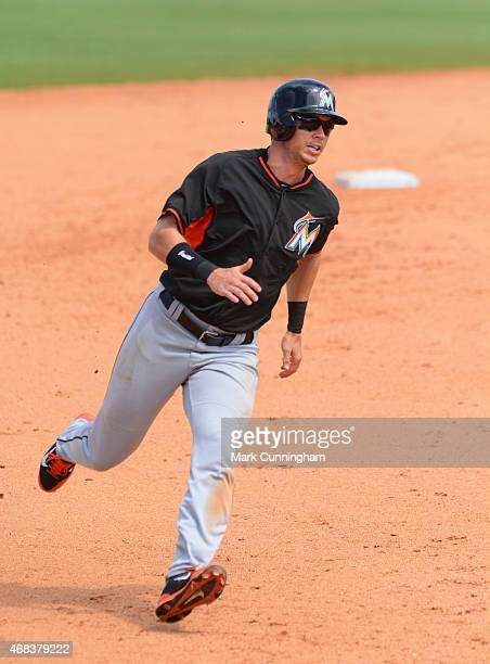 Tyler Colvin of the Miami Marlins runs the bases during the Spring Training game against the Detroit Tigers at Joker Marchant Stadium on March 25...