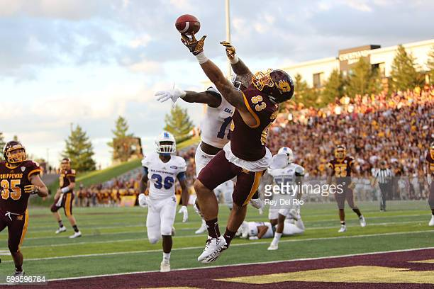 Tyler Conklin of the Central Michigan Chippewas tries to catch the ball against the Presbyterian Blue Hose at Kelly/Shorts Stadium on September 1...