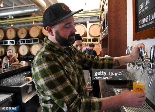 Tyler Conn pours a brand new beer Brace for Impact a double dry hopped double IPA at Cerebral Brewing February 23 2018