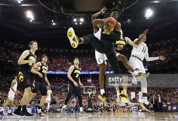 Tyler Cook of the Iowa Hawkeyes battles for a rebound against the Cincinnati Bearcats in the first round of the 2019 NCAA Men's Basketball Tournament...