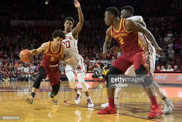 Tyler Cook of the Iowa Hawkeyes drives around Kameron McGusty of the Oklahoma Sooners during the first half of a NCAA college basketball game at the...