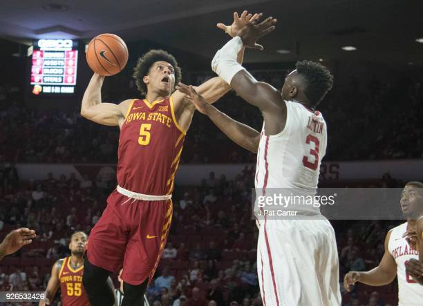 Tyler Cook of the Iowa Hawkeyes dunks the ball over Khadeem Lattin of the Oklahoma Sooners during the first half of a NCAA college basketball game at...