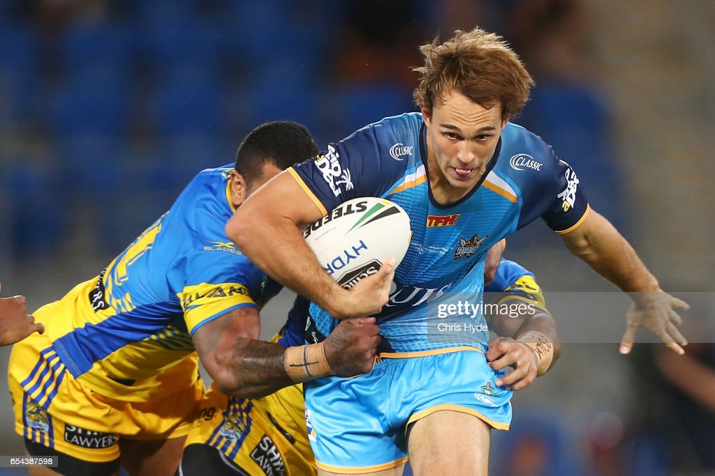 Tyler Cornnish of the Titans is tackled during the round three NRL match between the Gold Coast Titans and the Parramatta Eels at Cbus Super Stadium on March 17, 2017 in Gold Coast, Australia.