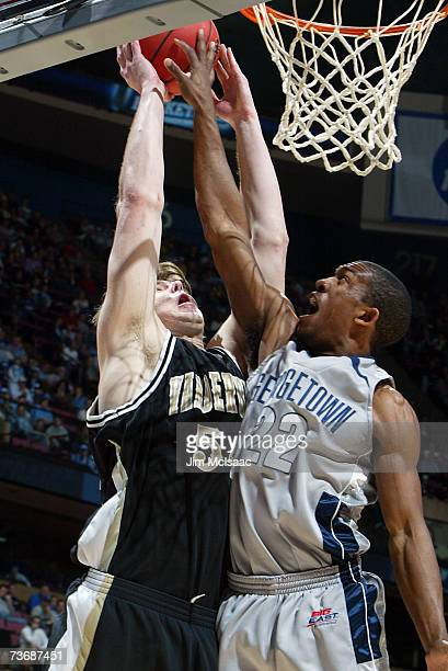 Tyler Crawford of the Georgetown Hoyas defends the shot of Ted Skuchas of the Vanderbilt Commodores during the NCAA Men's East Regional Semifinal at...
