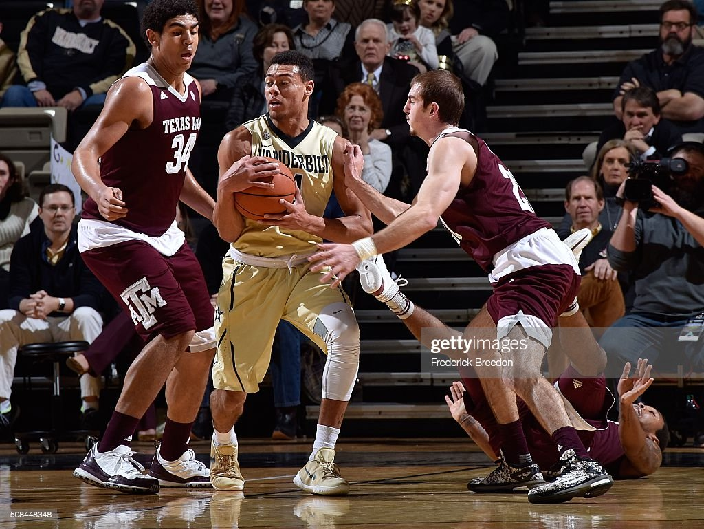 Tyler Davis #34 and Alex Caruso #21 of the Texas A&M Aggies sandwhich Wade Baldwin IV #4 of the Vanderbilt Commodores during the first half at Memorial Gym on February 4, 2016 in Nashville, Tennessee.