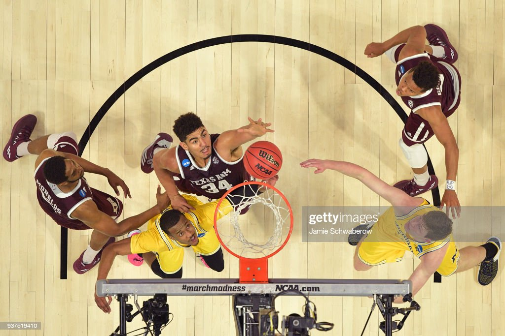 Tyler Davis #34 of the Texas A&M Aggies goes up for the rebound over Muhammad-Ali Abdur-Rahkman #12 of the Michigan Wolverines during the third round of the 2018 NCAA Men's Basketball Tournament held at Staples Center on March 22, 2018 in Los Angeles, California.