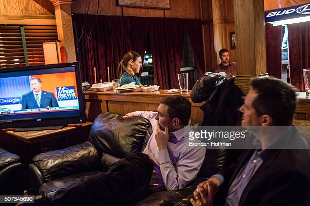 Tyler DeHaan and Jeff Angelo watch the Republican presidential debate at Mickey's Irish Pub on January 28 2016 in Waukee Iowa The Democratic and...