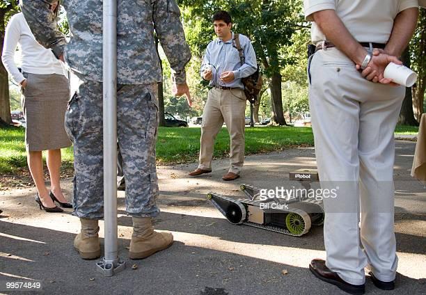 Tyler Dendas, associate mechanical engineer for iRobot Corp., demonstrates the iRobot SUGV for Congressional staffers at the Future Combat Systems...