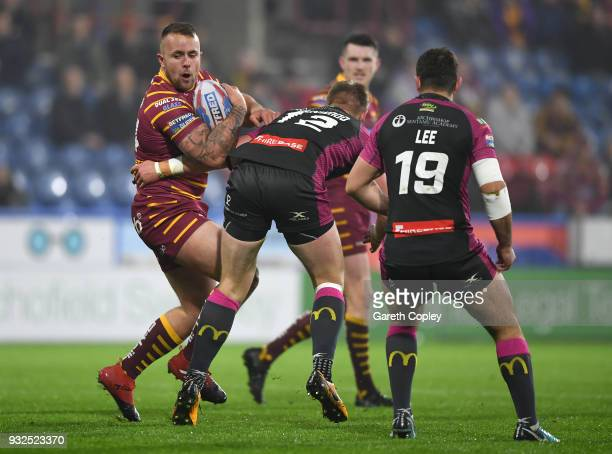 Tyler Dickinson of Huddersfield is tackled by James Greenwood of Hull KR during the Betfred Super League match between Huddersfield Giants and Hull...